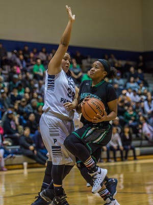 Farmington's Ha'teya Holloman drives against Piedra Vista's Nykki Benally on Thursday at the Jerry A. Conner Fieldhouse in Farmington.