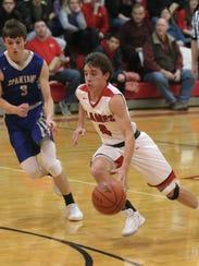Mansfield Christian'sKyle Kurtz moves the ball down