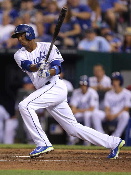 Kansas City Royals' Alcides Escobar hits a two-run triple in the seventh inning during a baseball game against the Minnesota Twins Thursday, July 31, 2014, in Kansas City, Mo.  (AP Photo/Ed Zurga)