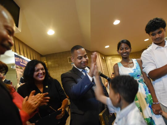 Mitsu Yasukawa/NorthJersey.com Hector Lora gets a high-five from his son Jirehiah, 7, after being sworn in as mayor of Passaic as his wife Nicauris, right, and his other children Yoel, 3, and Ymiej, 14, look on Sunday. Hector Lora gets a high five from his son Jirehiah (age 7) after being sworn in as Mayor of Passaic as his wife Nicauris (R) and his other children Yoel (age 3), and Ymiej (age 14) look on prior to the re-organization meeting of the City Council at Dr. Martin Luther King Jr. School #6 in Passaic on July 2nd, 2017.