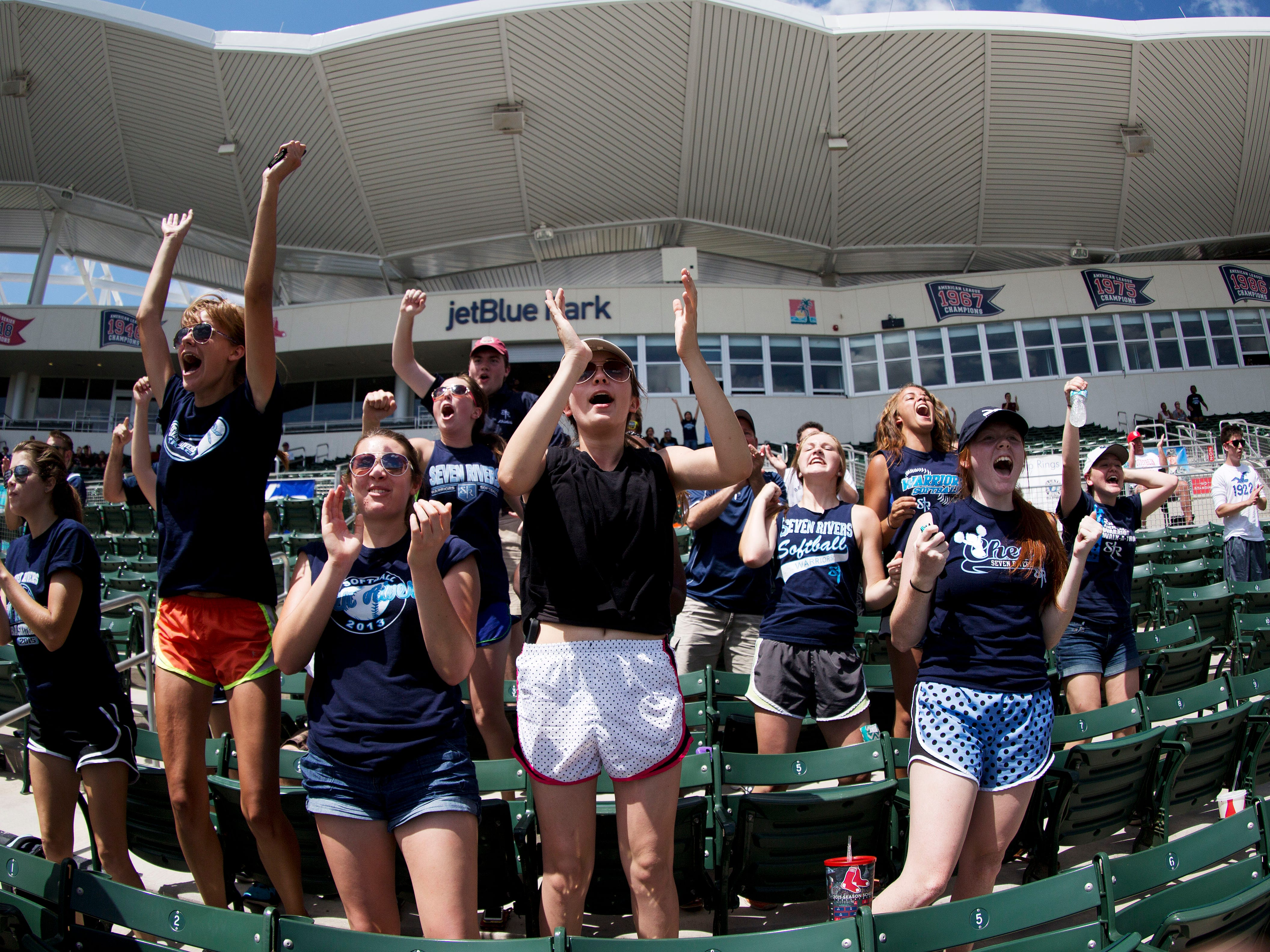 Students of Seven Rivers Christian School cheer on their team in the FHSSA state 2A baseball semi-final games against Bayshore Christian School on Wednesday. Seven Rivers ended up losing in 11 innings 4-3.