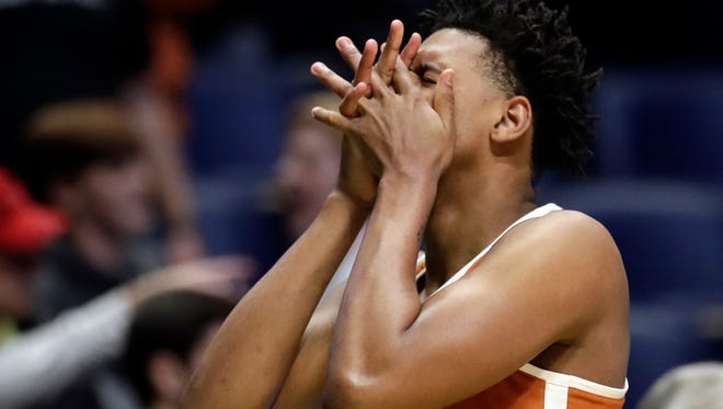 Texas forward Royce Hamm Jr. reacts after losing in overtime.