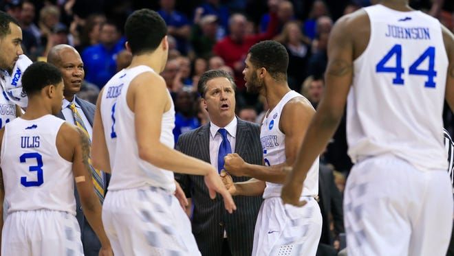 Kentucky head coach John Calipari talks with Andrew Harrison late in the second half of the Elite Eight game Saturday at Quicken Loans Arena in Cleveland.  The Wildcats prevailed 68-66 however and go on to the Final Four in Indianapolis.  March 28, 2015. By Matt Stone, The C-J