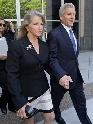 Former Virginia Gov. Bob McDonnell, right, and his wife Maureen, center, leave Federal court  after a motions hearing in Richmond, Va., on Monday, May 19, 2014.  The Republican former governor and his wife are charged in a 14-count indictment with accepting more than $165,000 from Jonnie Williams, the former CEO of dietary supplements maker Star Scientific Inc., in exchange for helping promote his products.