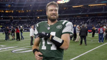New York Jets quarterback Ryan Fitzpatrick smiles as he walks off the field following the Jets' victory over the Dallas Cowboys in Arlington, Texas, a week ago Saturday. The Jets host the New England Patriots on Sunday in East Rutherford, N.J.