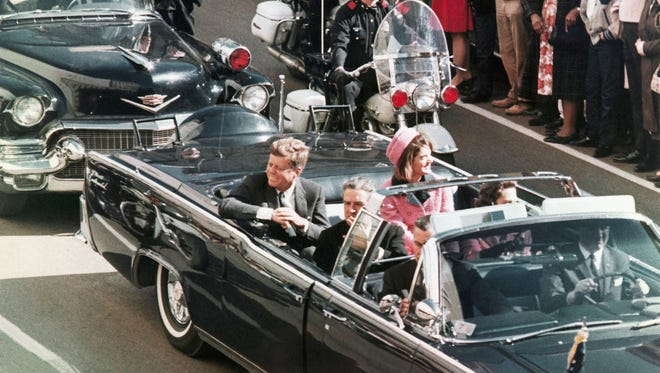In this Nov. 22, 1963 file photo, President John F. Kennedy's motorcade travels through Dallas.
