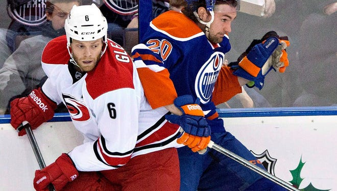 Tim Gleason, left, is headed from Carolina to the Toronto Maple Leafs in a trade announced on New Year's Day.