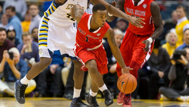 FILE -- Ball State Cardinals guard Zavier Turner (1) heads up court with the basketball ahead of Marquette's Chris Otule (42), Dec. 17, 2013.