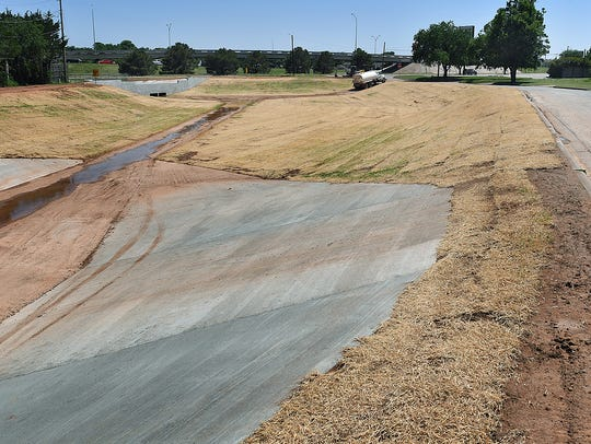 In this file photo, a large drainage basin is seen along Monroe Street and the Kell West access road. A change order to the Kemp-Monroe drainage project will allow for replacement of a cast iron main, a manhole and portion of sewer line.