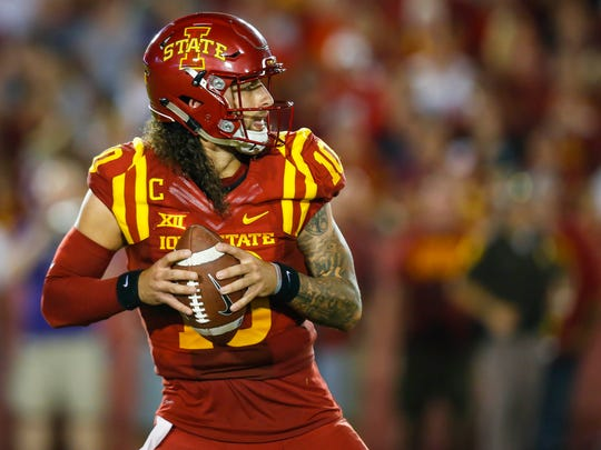 Iowa State quarterback Jacob Park (10) fades back to