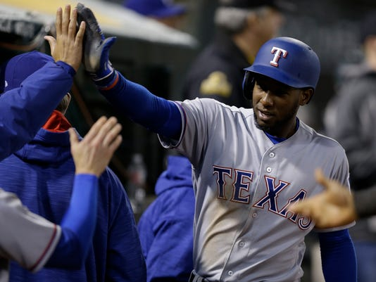 Texas Rangers' Jurickson Profar celebrates after scoring against the Oakland Athletics during the sixth inning of a baseball game Tuesday, April 18, 2017, in Oakland, Calif. (AP Photo/Ben Margot)