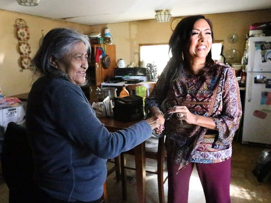 "Gloria Gonzales Ramirez, left, receives a visit from Elizabeth Silva, program specialist for the Rio Grande Area Agency on Aging, on Tuesday at her mobile home in Fabens. ""I wouldn't know what to do without them,"" Gonzales Ramirez said."