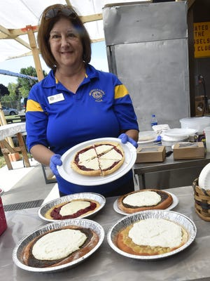 Gina Guth prepares Belgian pies for serving-size slices during Belgian Days in Brussels on July 15. Brussels Lion Club volunteers sold all of the 450 pies. For more photos, visit doorcountyadvocate.com