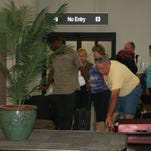 Travelers take corridor leading to security checkpoint at Punta Gorda Airport's Bailey Terminal.  A new, 40,000-square-foot addition to the terminal opened Monday, Sept. 14, 2015.