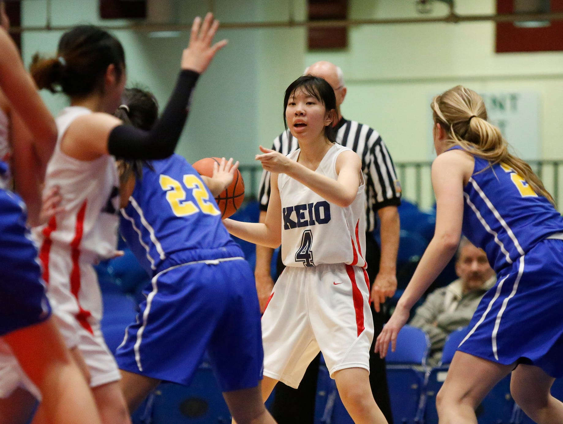 Keio's Marina Kofukugawa (4) calls a play against North Salem in the class C semi-final basketball game at the Westchester County Center in White Plains on Saturday, February 27, 2016.