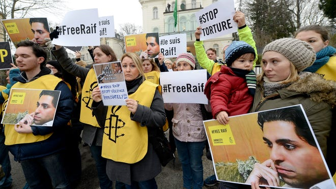 An Amnesty International protest in front of the Saudi Embassy in Vienna, Austria, Jan. 16,  2015, against the flogging of Saudi blogger Raif Badawi.