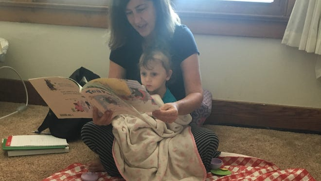 Jennifer Gunderman, a parent educator with St. Clair Great Start Collaborative, works with Felicity Eisen, 2, during a home visit.