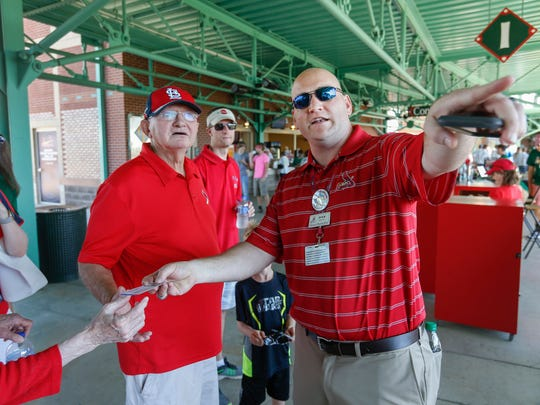 New Springfield Cardinals general manager Dan Reiter, right, helps fans find their seats before the game on Wednesday, June 21, 2017.