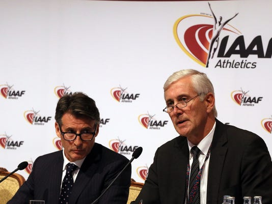 IAAF President Sebastian Coe, left, and and Rune Andersen Chair of IAAF Inspection Team attend a news conference after a meeting of the IAAF Council at the Grand Hotel in Vienna, Austria, Friday, June 17, 2016. The IAAF upheld its ban on Russia's track and field team for the Rio de Janeiro Olympics in a landmark decision that punishes the world power for systematic doping. (AP Photo/Ronald Zak)