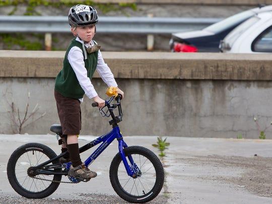 Holden Berg, 6, of Iowa City sports a sweater vest