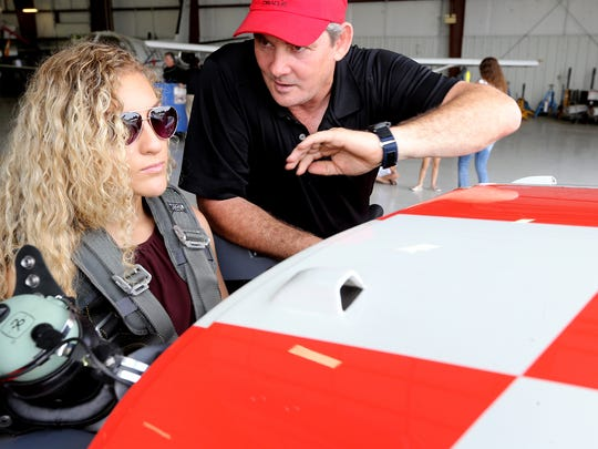Myah Hasam, left, gets some last-minute instructions and advice from Chris Rudd before flying with Sean D. Tucker in Tucker's Oracle plane on June 2, 2016, as part of an Eagle flight. Tucker was one of the performers participating in the Great Tennessee Air Show at the Smyrna Airport.