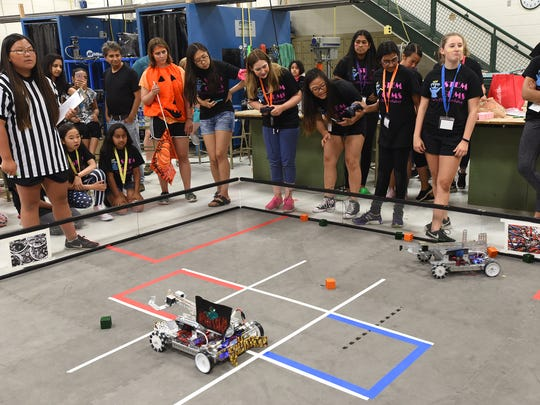 Robotic competition gets underway in the late morning at Novi High during the last day of the school's summer Girls' STEM Workshop. Teams were trying to place plastic boxes in the squares in a robot-version of tic-tac-toe.