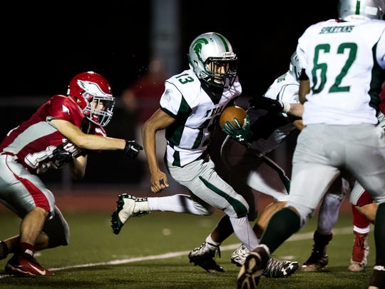 York Tech's Julio Pascual (13) runs the ball during