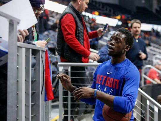 Reggie Jackson signs autographs before a game against the Hawks in Atlanta on Dec. 14, 2017.