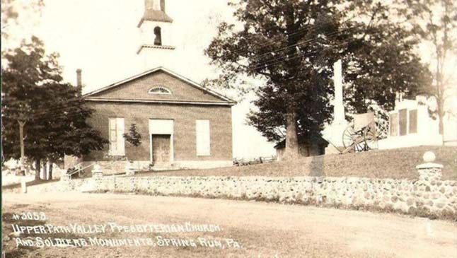 A historic postcard by Shippensburg photographer Clyde Laughlin shows Upper Path Valley Presbyterian Church and its graveyard in the early 20th century.