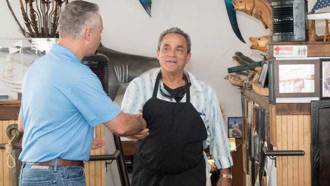 St. Lucie County Tax Collector Chris Craft thanks Chuck's Seafood Restaurant owner Peter Angelos for graciously donating all of the food at the third annual Local Celebrity Lunch benefiting Donate Life Florida.