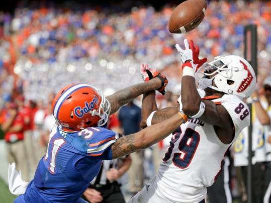 FILE - In this Nov. 21, 2015, file photo, Florida defensive back Jalen Tabor (31) breaks up a pass intended for Florida Atlantic wide receiver Darius James (89) during the second half of an NCAA college football game, in Gainesville, Fla. The Southeastern Conference's two stingiest defenses will take the field in the league championship game.  (AP Photo/John Raoux, File)