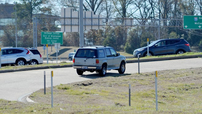 A vehicle merges onto Lakeland Drive from I-55 north entrance ramp off the interstate.
