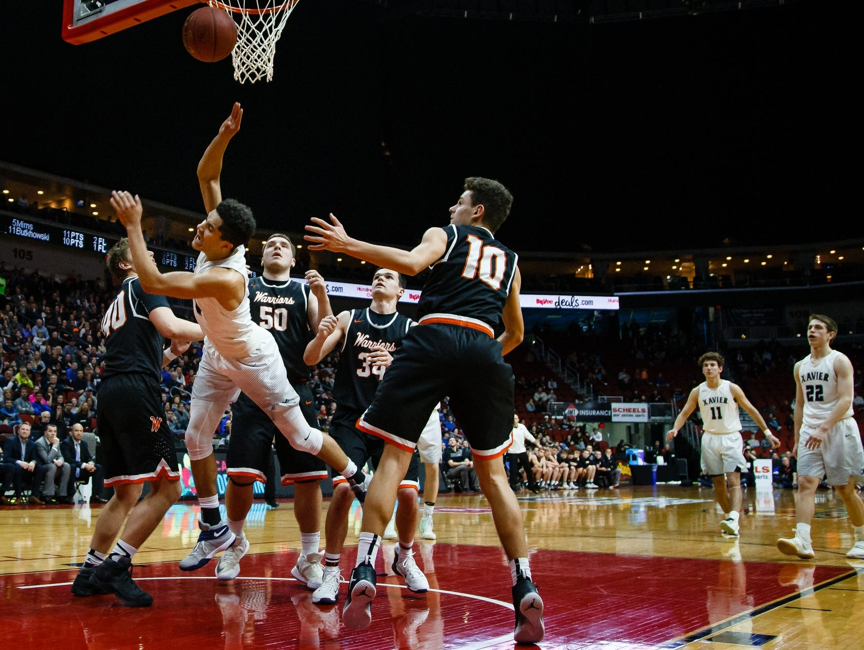 Cedar Rapids, Xavier's Matthew Mims (5) is fouled during their 3A state basketball championship game on Saturday, March 11, 2017, in Des Moines. Cedar Rapids, Xavier would go on to win 54-49.