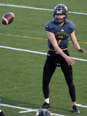 Newton quarterback Ben Schmidt passed for 218 yards and a touchdown in a 30-10 loss to Maize South Friday.