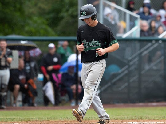 Raritan's Tyler Bruno scores Raritan's first run on a walk in the third inning.