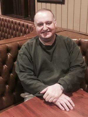 Elia Nicholas, 58, in his Highland House restaurant in Highland.