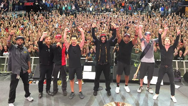 Dan Auerbach (second from left) and Matt Shultz (far right) joined Prophets of Rage at Bridgestone Arena in Nashville