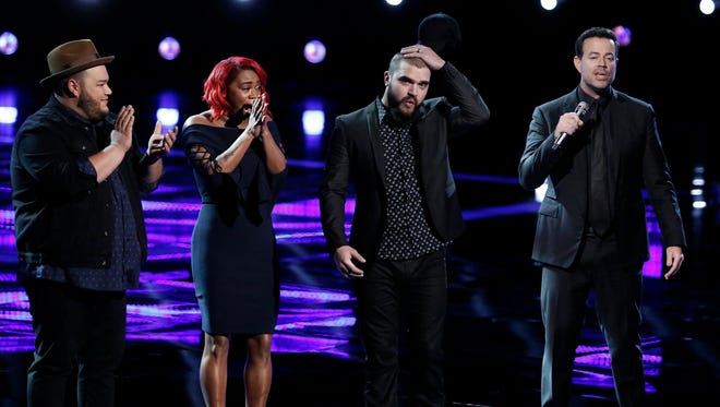 Nashville resident Josh Gallagher, second from right, reacts as he learns he's part of the Top 4 on 'The Voice;