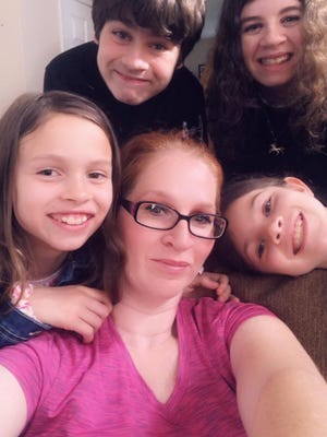 Navy veteran and home caregiver Kristin Chaffin and her children. Chaffin is the recipient of the 2020 Capt. Joseph McConnell Jr. Scholarship, in honor of America's all-time top-scoring fighter jet ace.