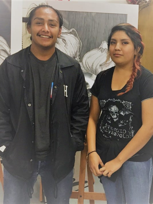 Nelson Kaydahzinne and Sharena Burgess, Mescalero Apache School students won art awards
