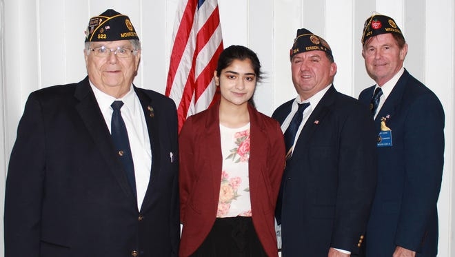Left to right: Nick Ferrarotto, Post 522 commander, Ria Patel; Mike Stolte, county Oratorical Contest chair; and Gary Cooper, Middlesex County American Legion commander.