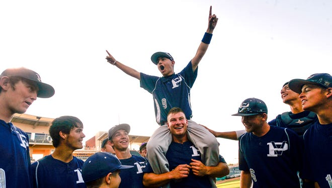 Justin Solomon celebrates with his teammates after winning the 4A State Championship game against Miyamura on May 12, 2012 at Isotopes Park in Albuquerque.