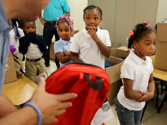 Ethicon, a company in Blue Ash, supplies every student with colorful backpacks filled with supplies the first week of school.