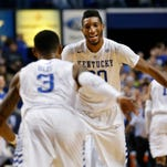Kentucky's Tyler Ulis and Marcus Lee celebrate after Lee energizes the crowd with a slam dunk.