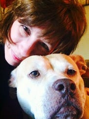 Kelly Fender, with the rescued female pitbull she nicknamed