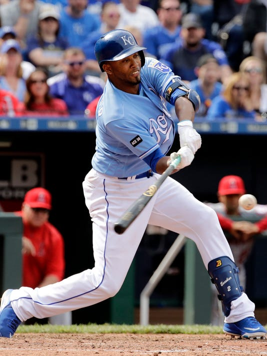 Kansas City Royals' Alcides Escobar hits a walk-off RBI single in the ninth inning to win a baseball game against the Los Angeles Angels, Sunday, April 16, 2017, in Kansas City, Mo. The Royals won 1-0. (AP Photo/Charlie Riedel)
