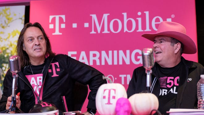T-Mobile CFO Braxton Carter, at right, alongside CEO John Legere.