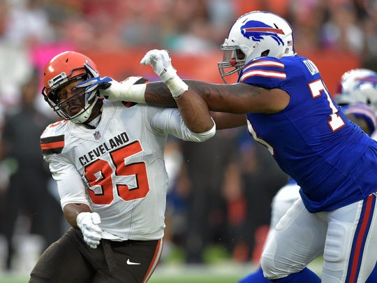 Cleveland Browns defensive end Myles Garrett (95) is stopped by Buffalo Bills offensive tackle Dion Dawkins (73) in the first half of an NFL football preseason game, Friday, Aug. 17, 2018, in Cleveland. (AP Photo/David Richard)