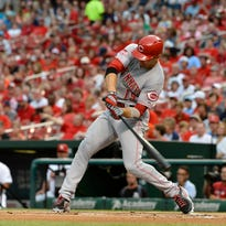 Cincinnati Reds first baseman Joey Votto (19) hits a double.