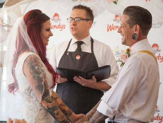 Abram Thompson and Jessica Aikens are married by radio host Mikey Foley at Wendy's on Friday, June 22, 2018.